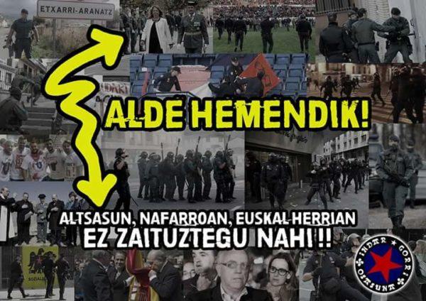 """""""Alde Hemendik"""" aldarriaren logotipoa den gezi hau aipatzen du epaileak. Irudian Indar Gorri futbol zaleen kartel batean."""